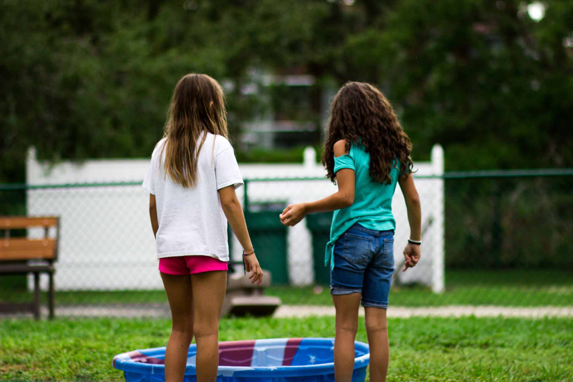 Girls playing near wading pool